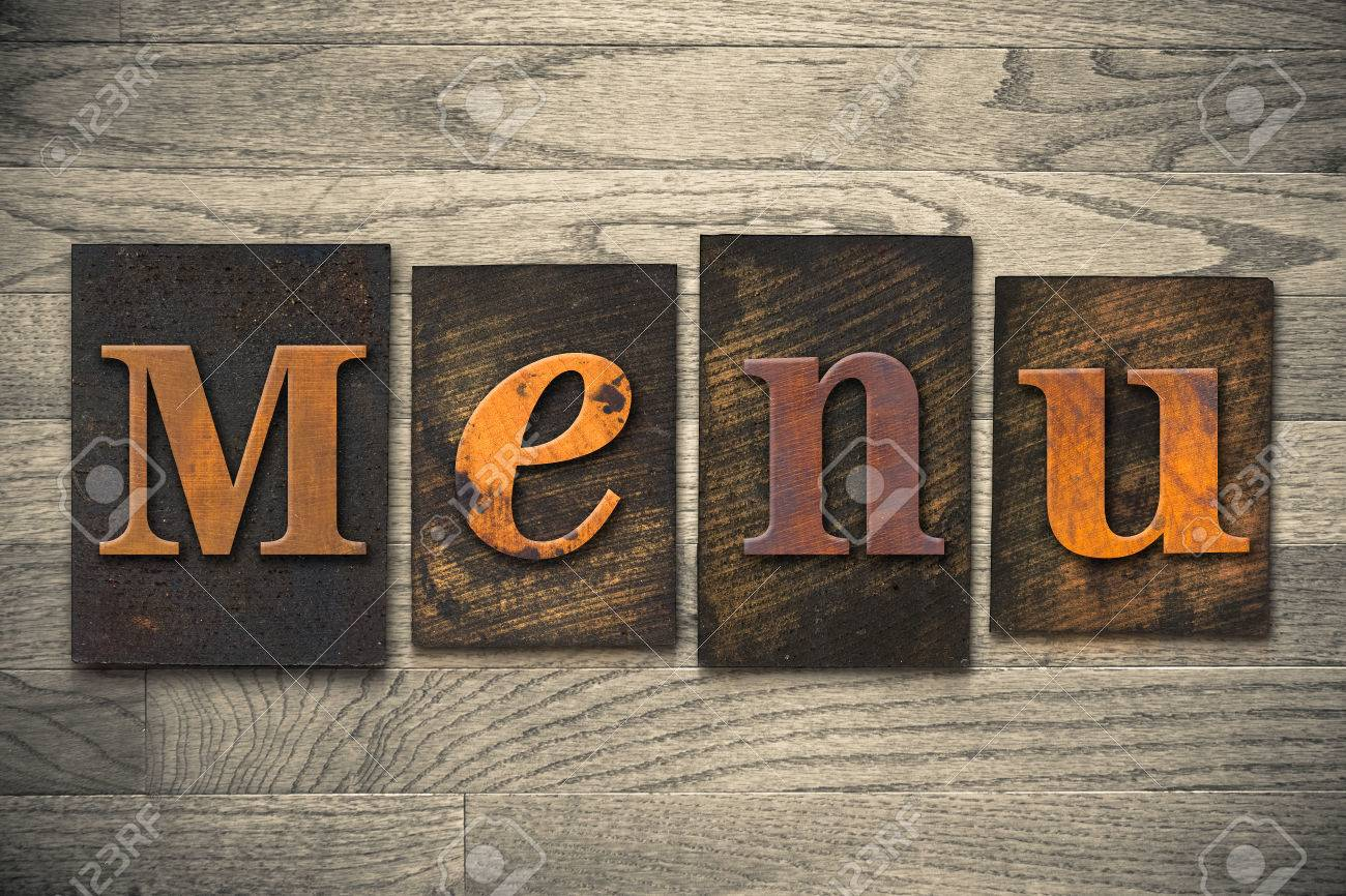 "the word ""menu"" written in wooden letterpress type. stock photo"