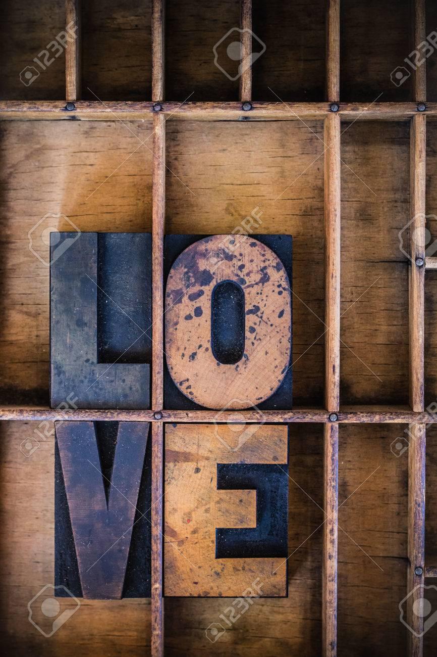 The word love written in vintage wooden letterpress type in a
