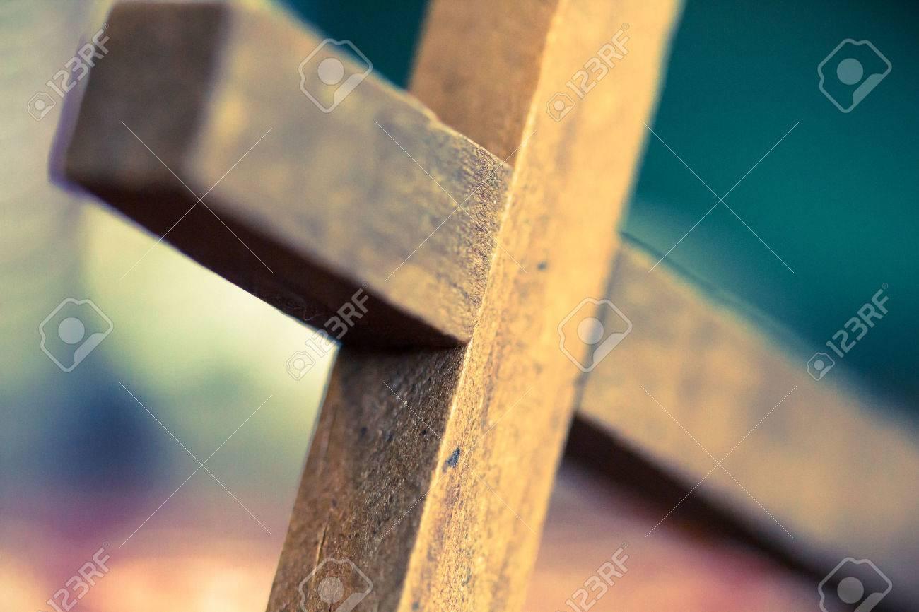 A Macro Closeup Of A Wooden Christian Cross Laying At An Angle