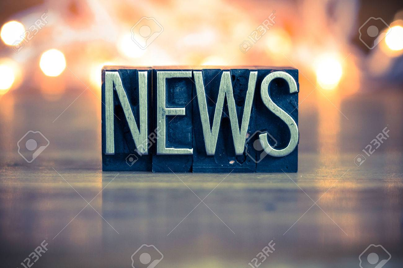 The word NEWS written in vintage metal letterpress type on a soft backlit background. - 41854982