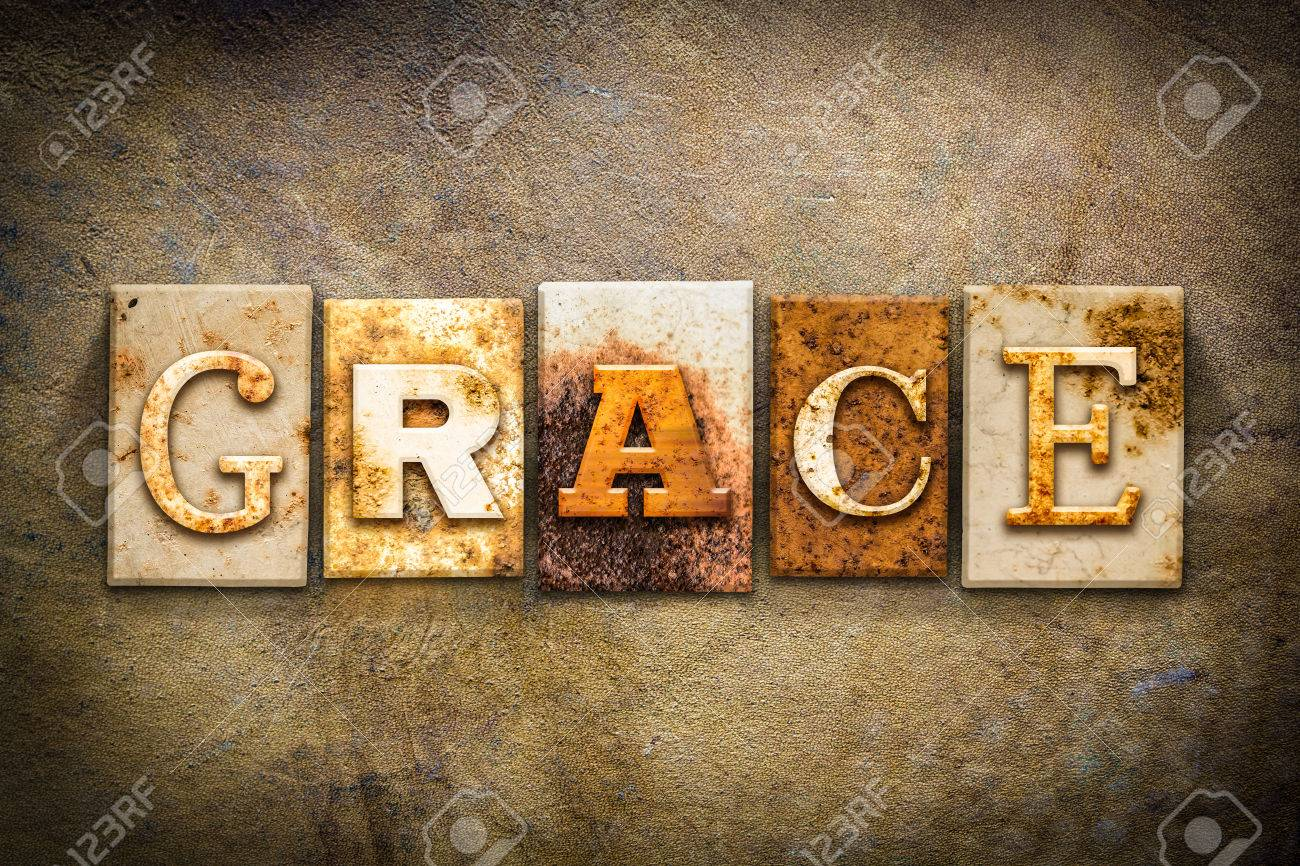 """The word """"GRACE"""" written in rusty metal letterpress type on an old aged leather background. - 44167342"""