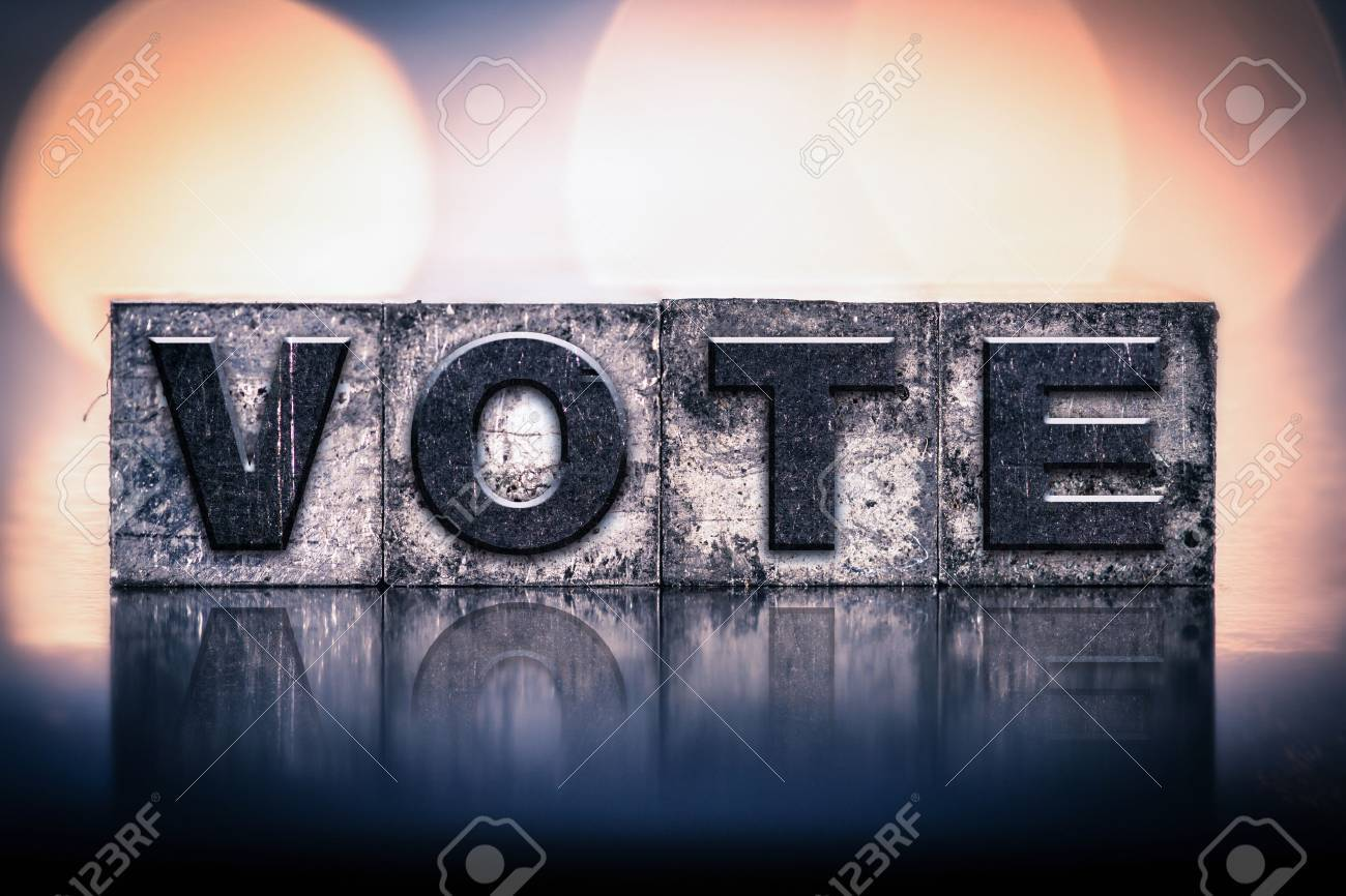 """The word """"VOTE"""" written in vintage ink stained letterpress type. - 48011351"""