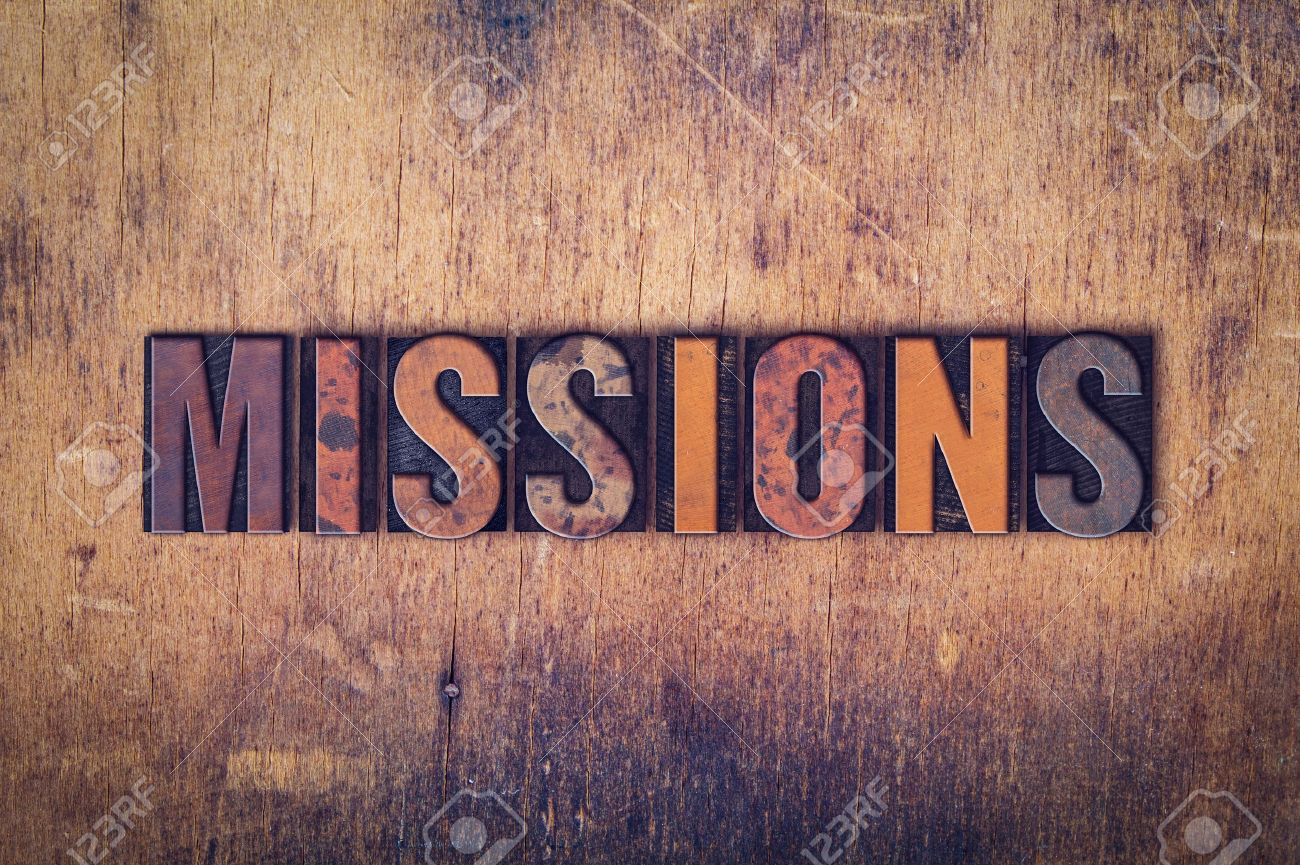"""The word """"Missions"""" written in dirty vintage letterpress type on a aged wooden background. - 50837118"""