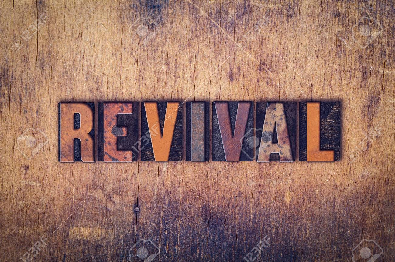 """The word """"Revival"""" written in dirty vintage letterpress type on a aged wooden background. - 50836832"""