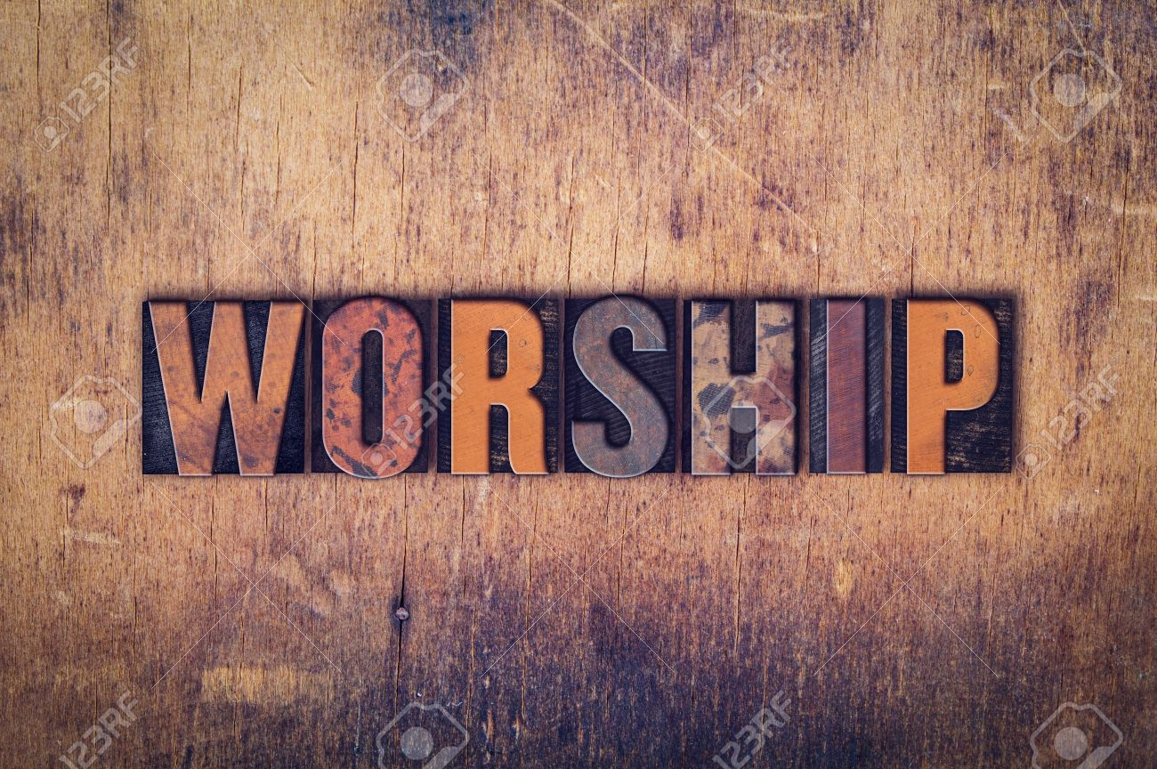 """The word """"Worship"""" written in dirty vintage letterpress type on a aged wooden background. - 50836797"""