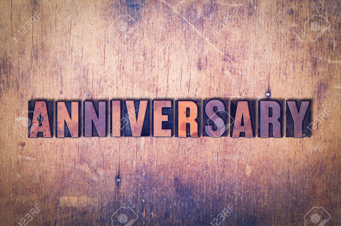 stock photo the word anniversary concept and theme written in vintage wooden letterpress type on a grunge background