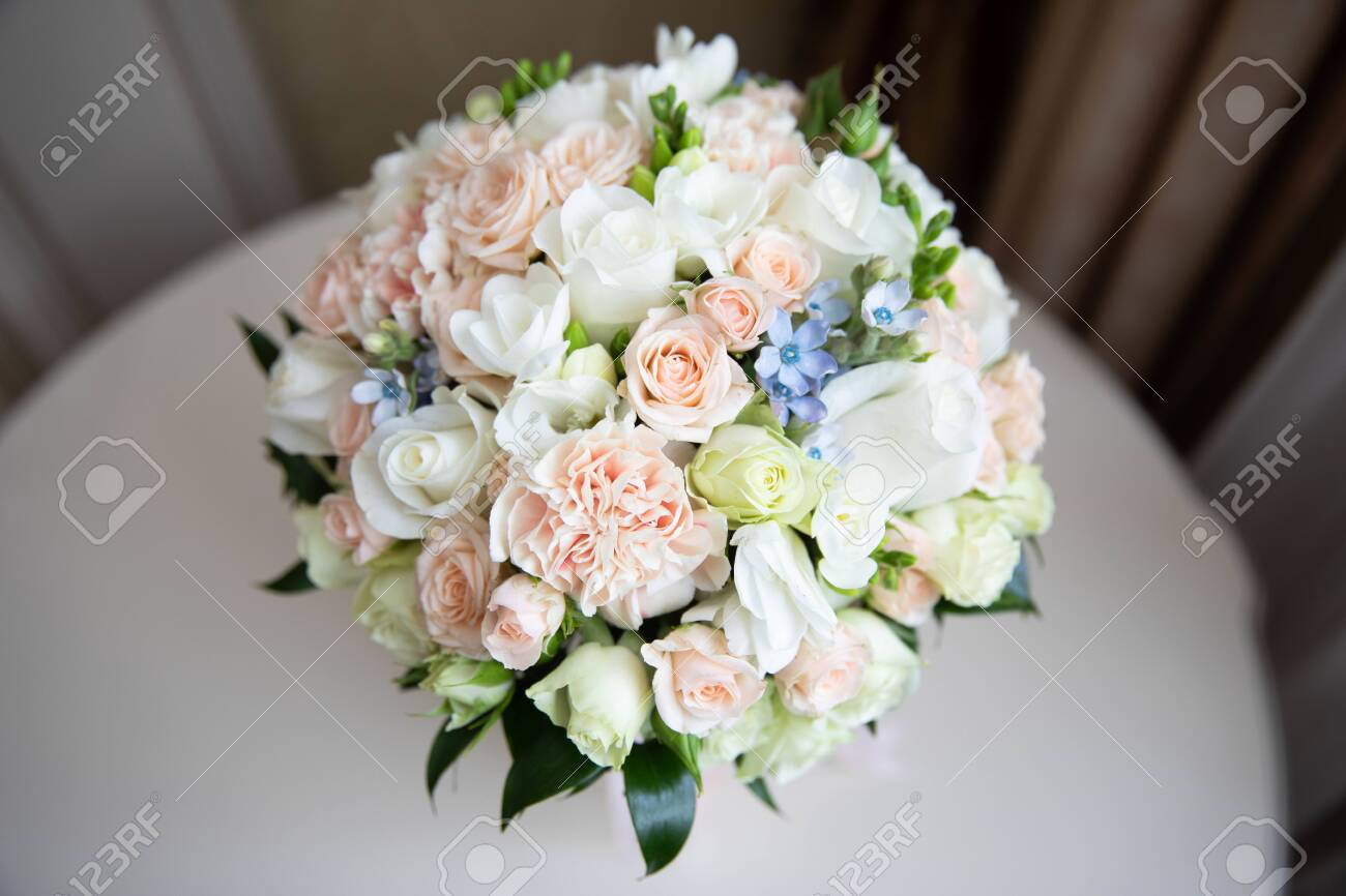 Delicate wedding bouquet of white and pink roses.Delicate wedding bouquet of white and pink roses - 144365796