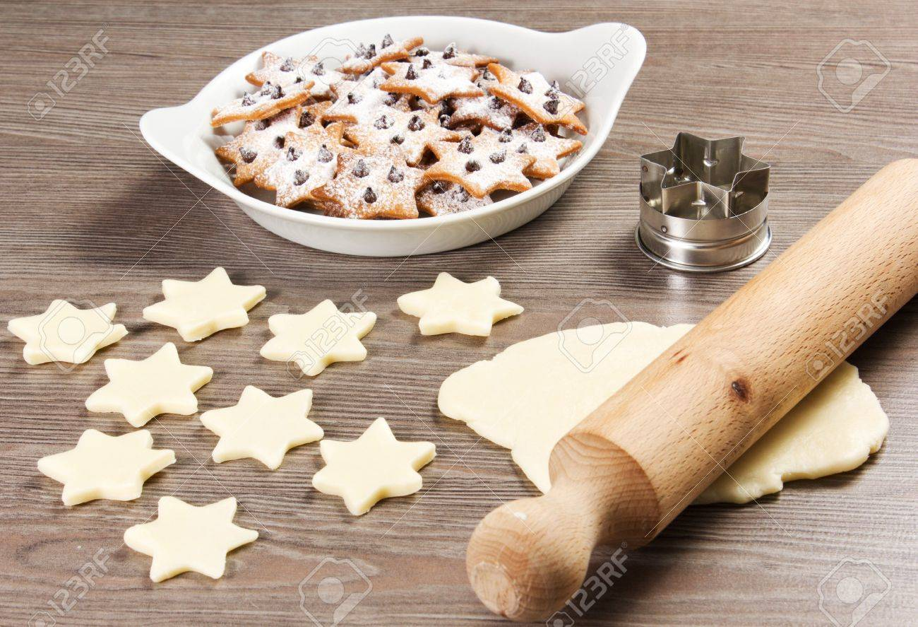 christmas star cookies  on the table with rolling pin Stock Photo - 17720425