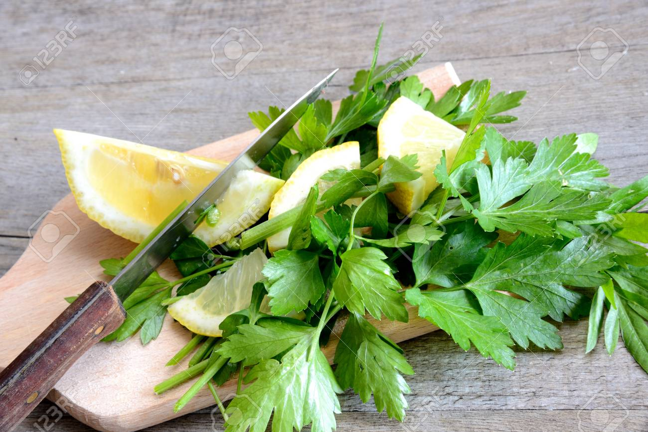 lemon and chopped parsley on wooden cutting board natural Stock Photo - 20448018