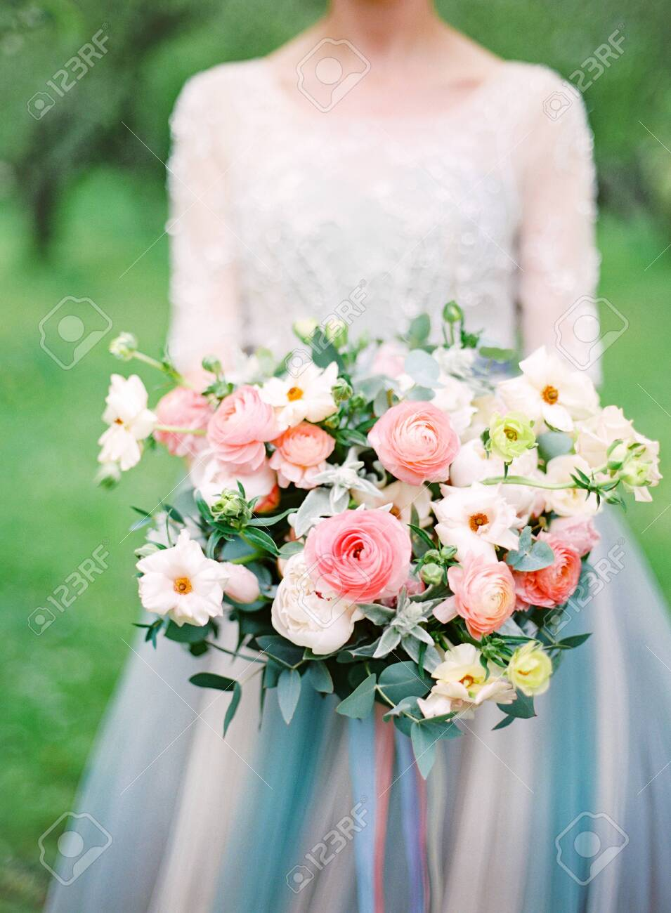 beautiful bride in white wedding dress with a bouquet. analog film photography - 131748875