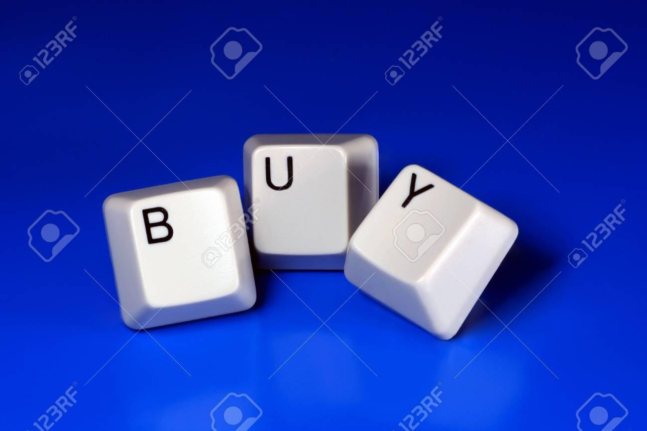 buy written with keyboard keys on blue background Stock Photo - 2546145