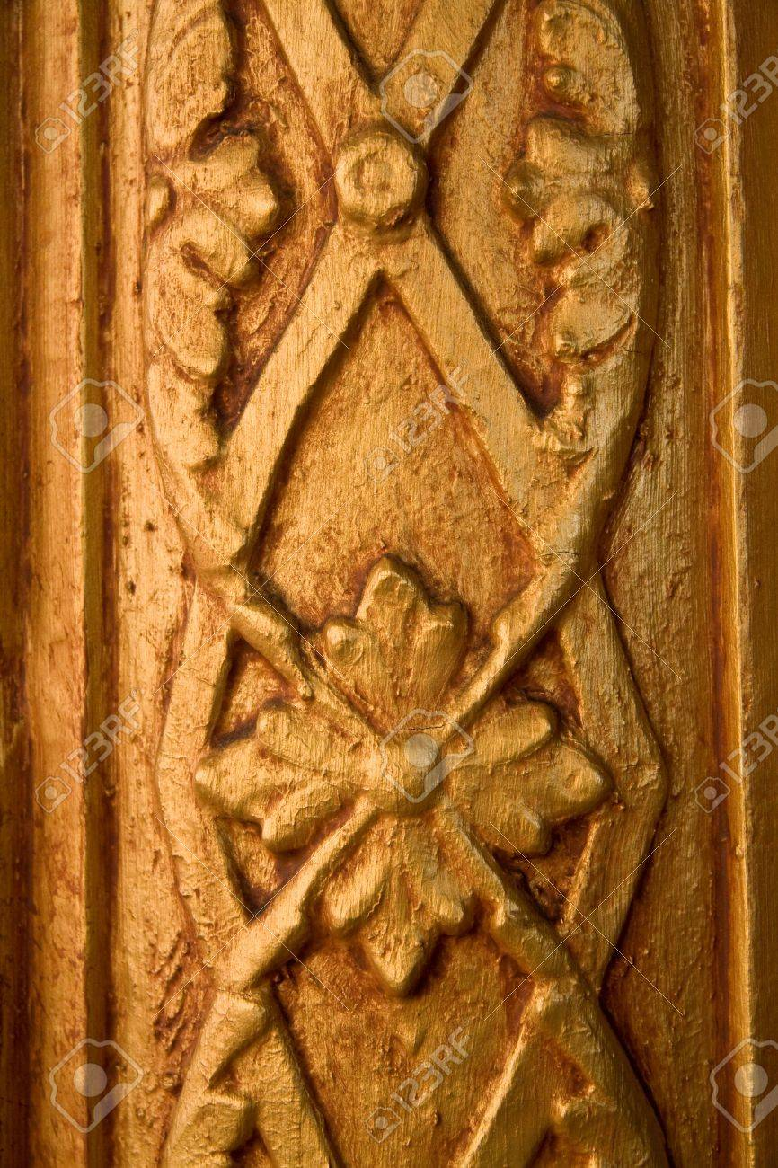 detail of carved gold wood decorative trim stock photo picture