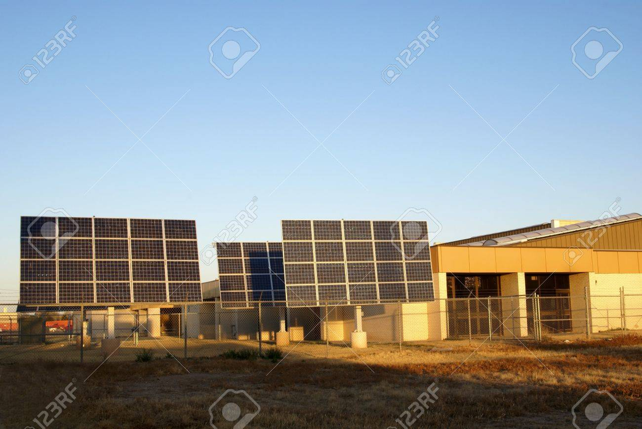 Solar Panel Array installation next to public school building in early morning sunlight Stock Photo - 4444721