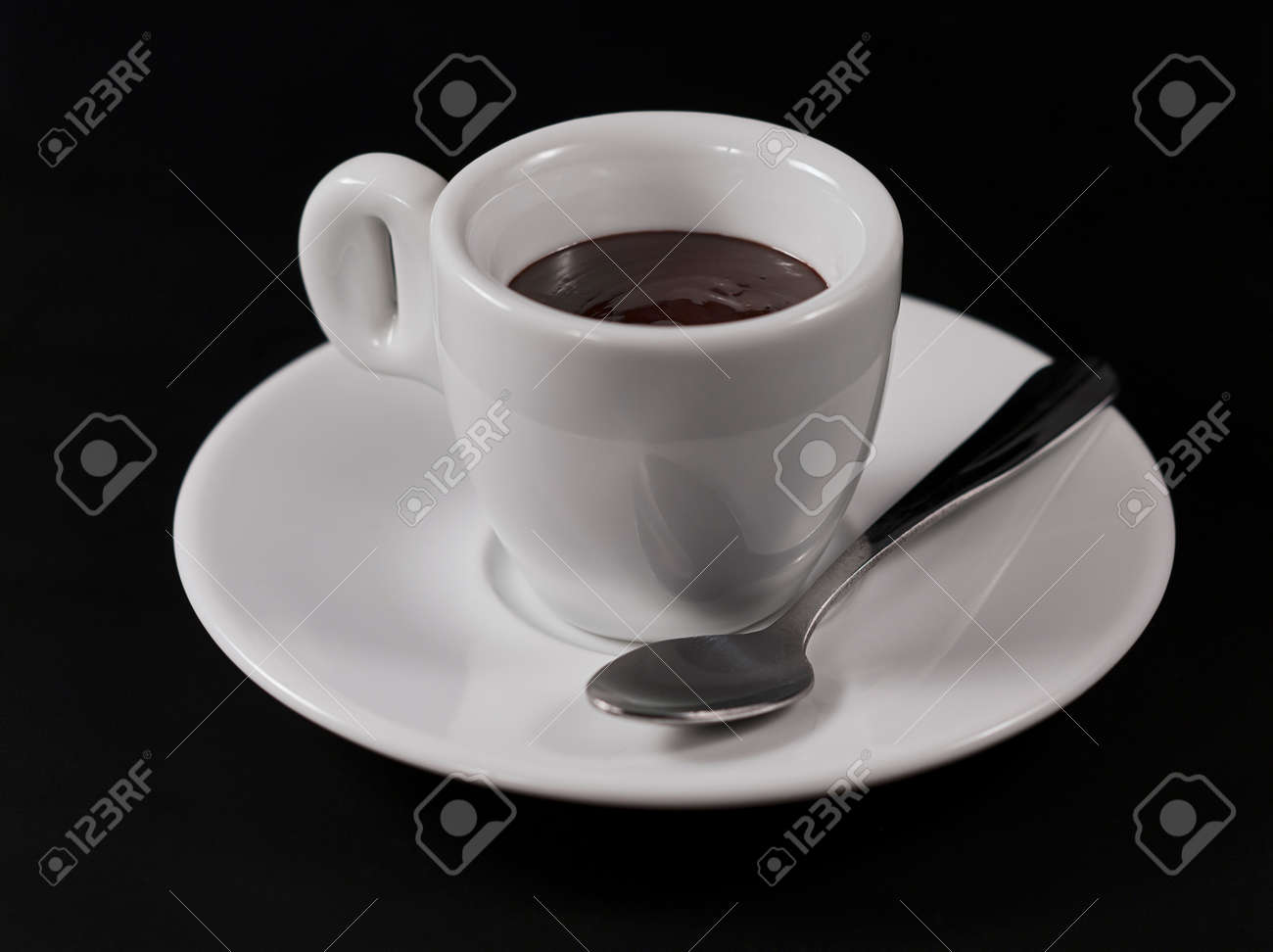 hot chocolate in a Cup on a black background - 144592184
