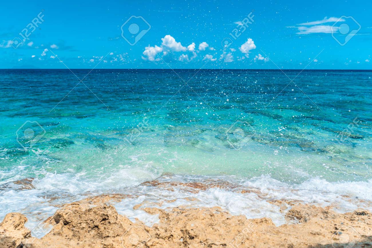 Blue sea water clashing on beautiful beach coast. - 152072479