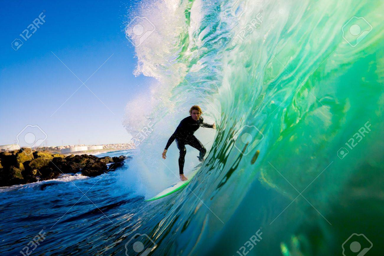 Surfer on Blue Ocean Wave Stock Photo - 11600006