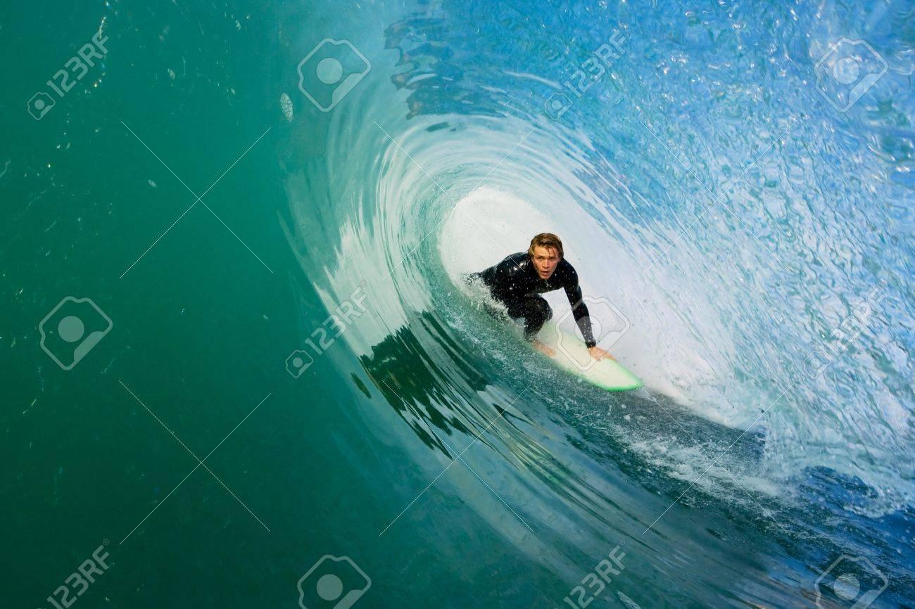 Surfer On Blue Ocean Wave Stock Photo - 11945999