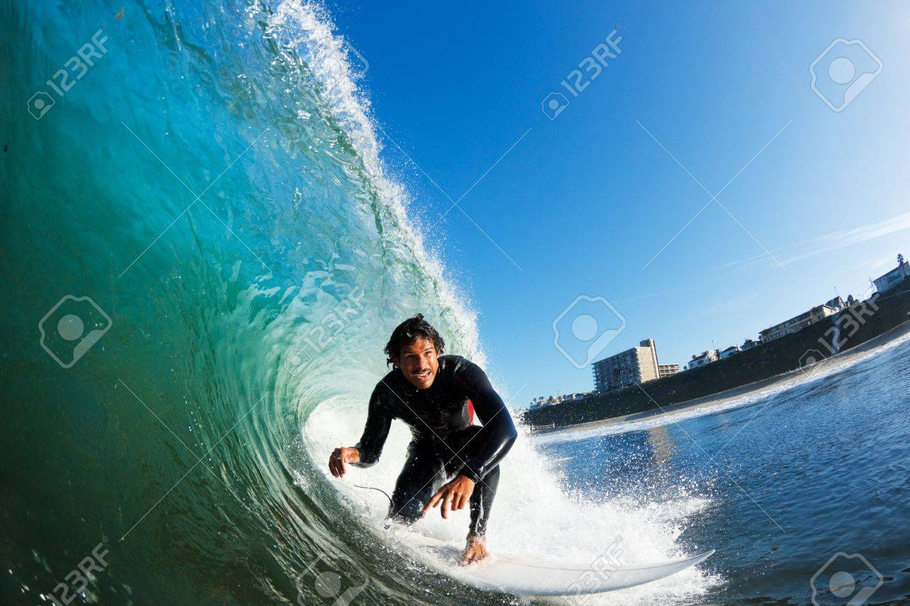 Surfer on Blue Ocean Wave, View from in the Water Stock Photo - 12066638