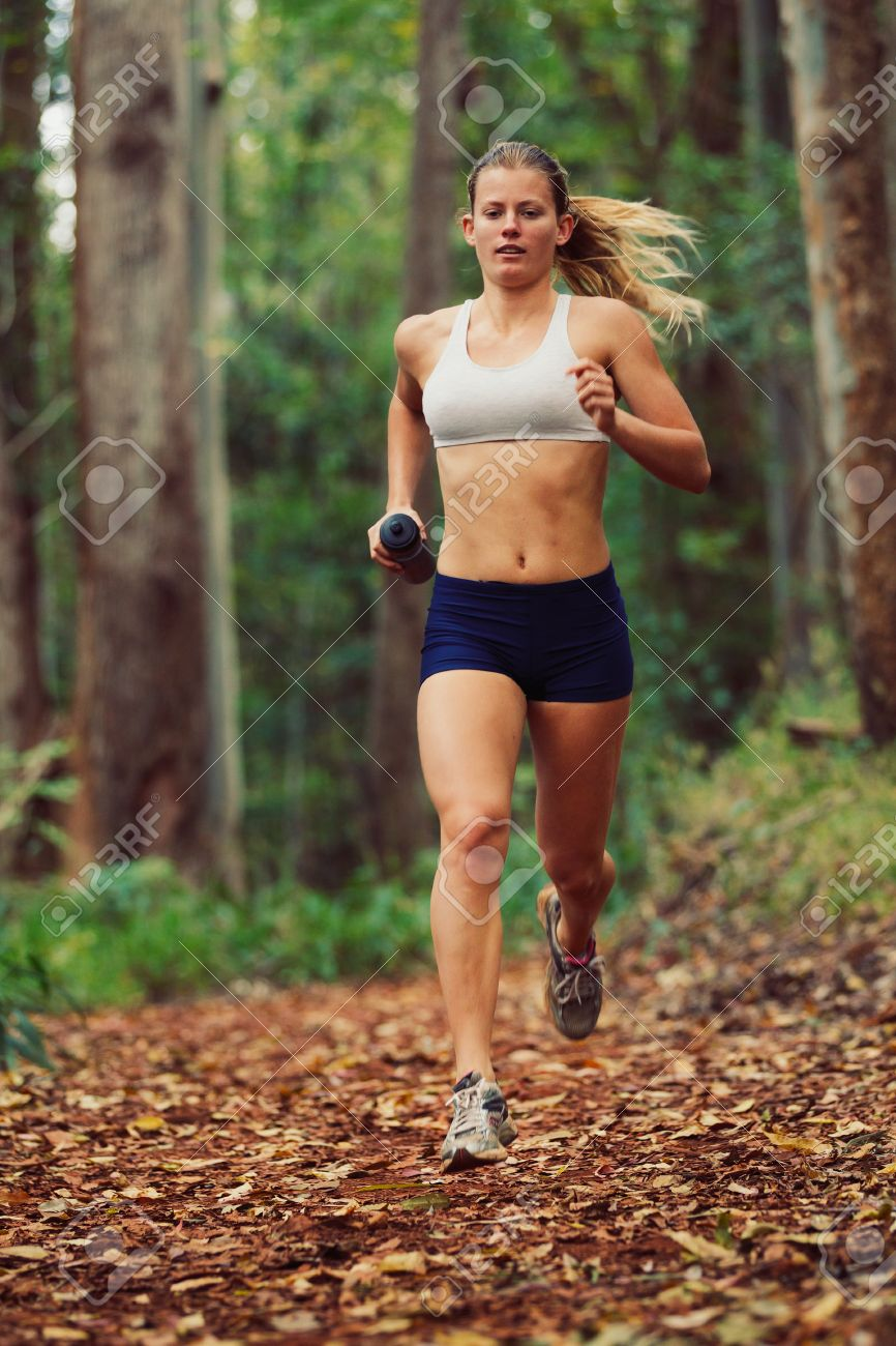 Woman Running Outdoors in Forest Stock Photo - 12952654