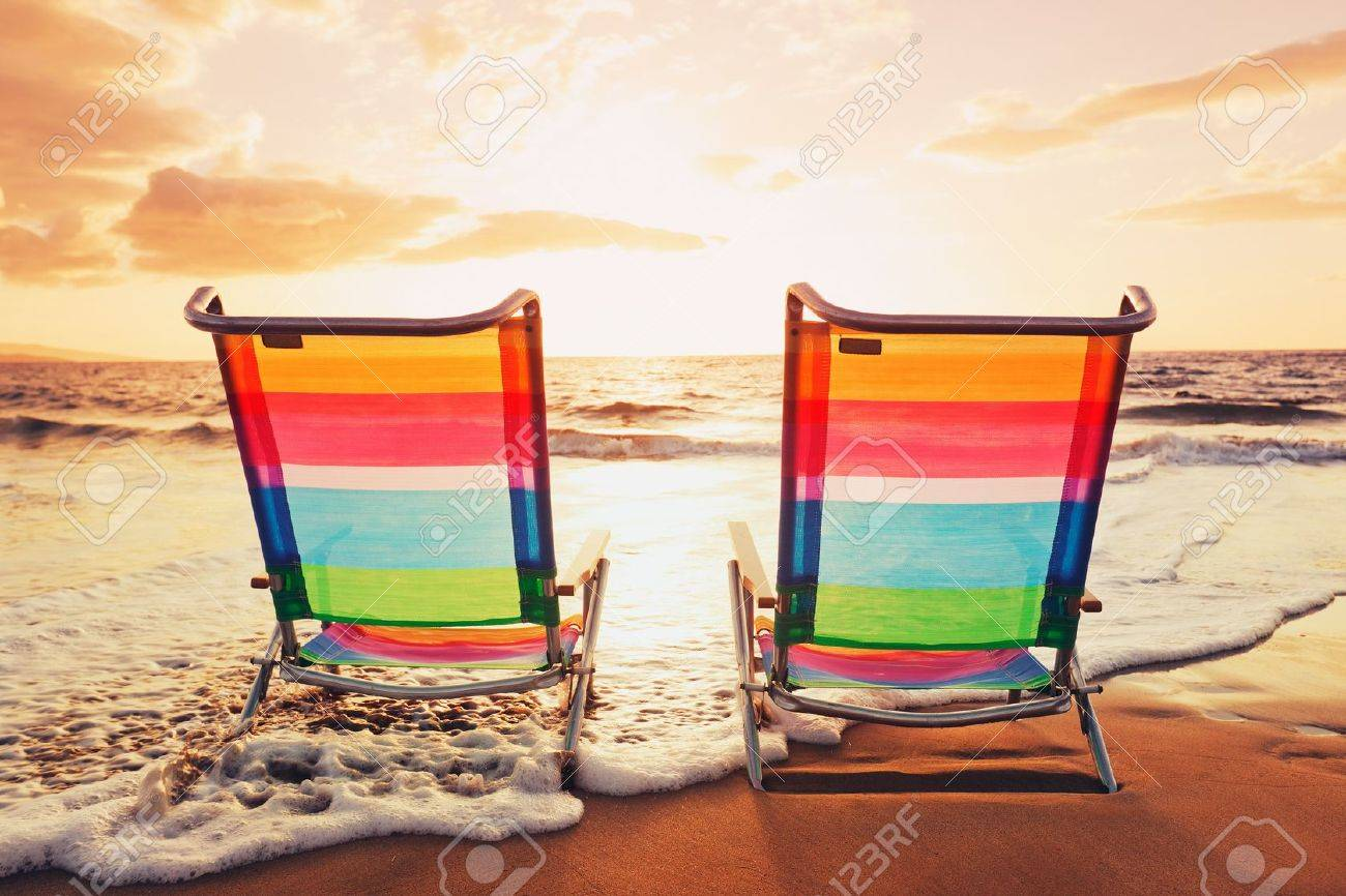 Beach sunset with chairs - Hawaiian Vacation Sunset Concept Two Beach Chairs At Sunset Stock Photo 12952696