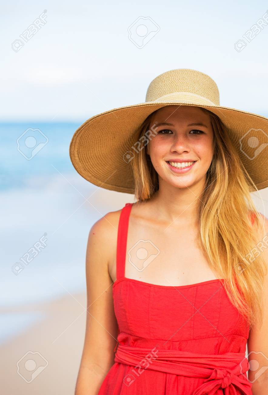 Happy Beautiful Woman in Red Dress on the Beach Stock Photo - 15871193