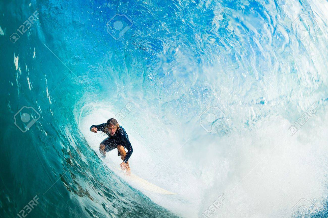 Surfer on Blue Ocean Wave in the Tube Getting Barreled Stock Photo - 16134484