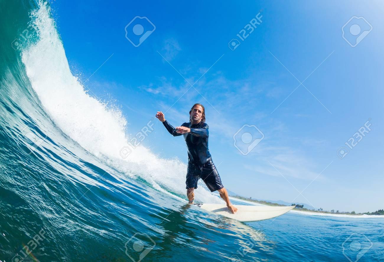 Surfer Riding Large Blue Ocean Wave Stock Photo - 16134626