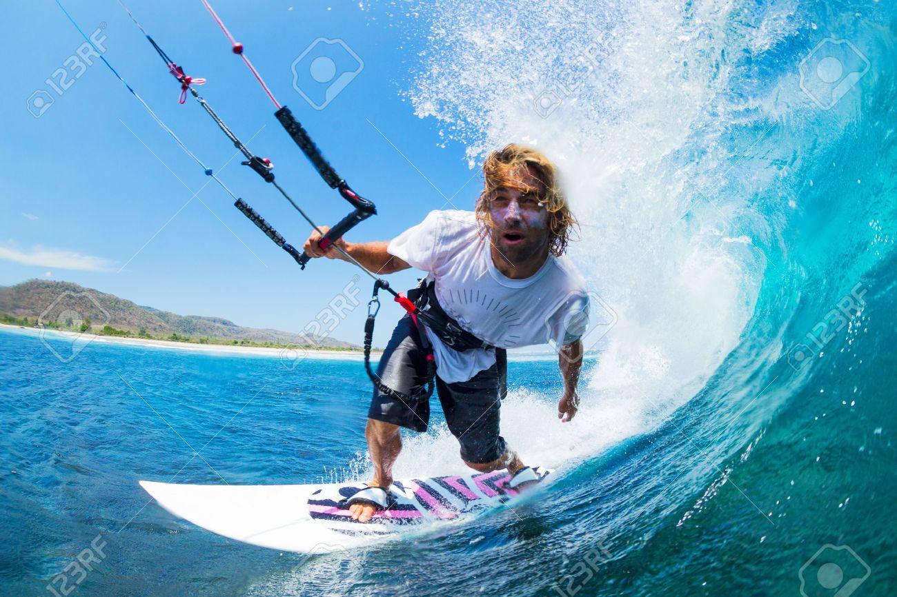 Extreme Sport, Kite Surfer Riding Wave getting Barreled - 19249301