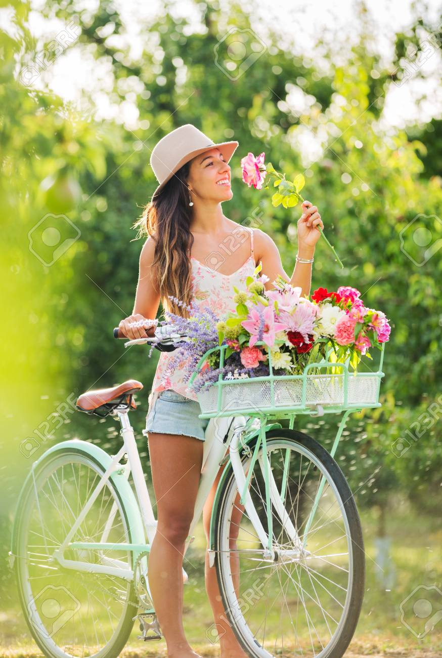 Beautiful Girl on Bike in Countryside, Summer Lifestyle Stock Photo - 21512153