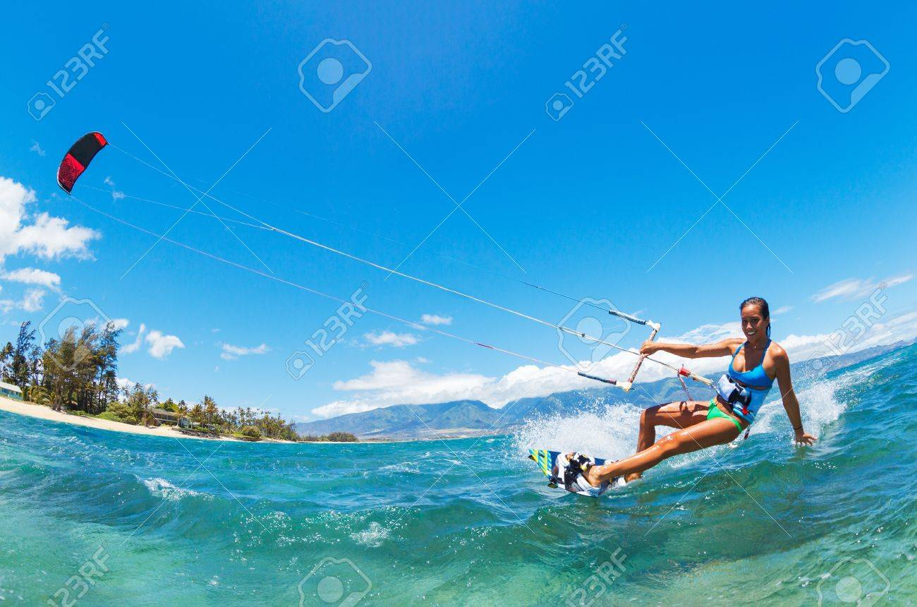 Attractive Young Woman KiteBoarding, Fun in the ocean, Extreme Sport Kitesurfing - 22168486
