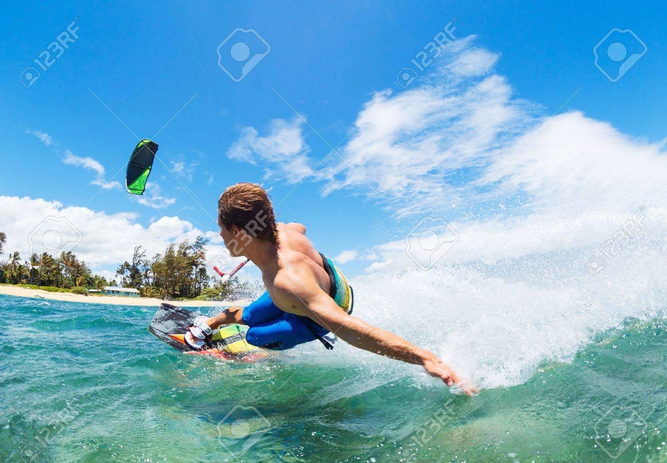 Young Man KiteBoarding, Fun in the ocean, Extreme Sport Kitesurfing - 22168497