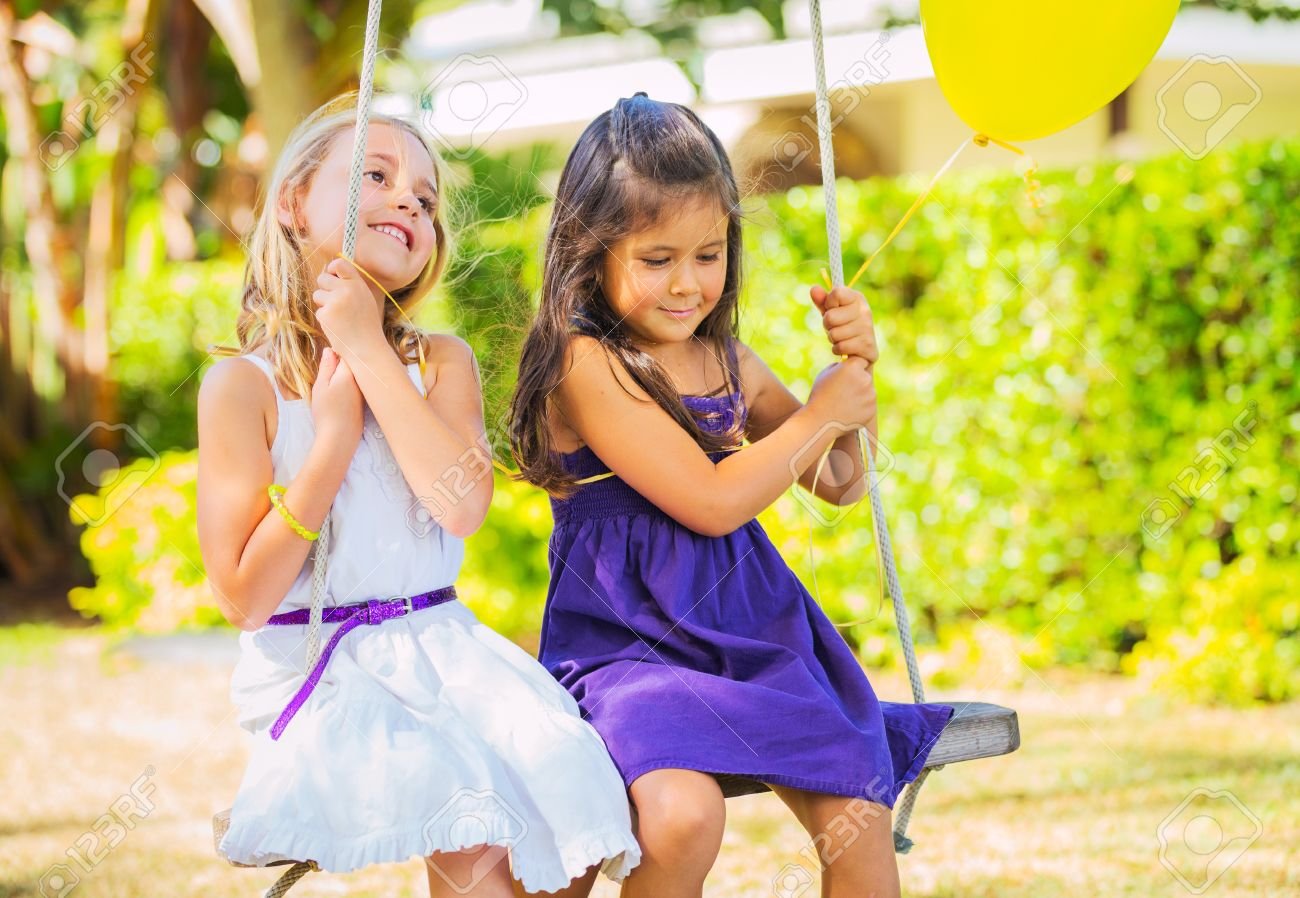 little girls playing two little happy little girls playing on swing stock photo 22168262 little on photo picture and royalty