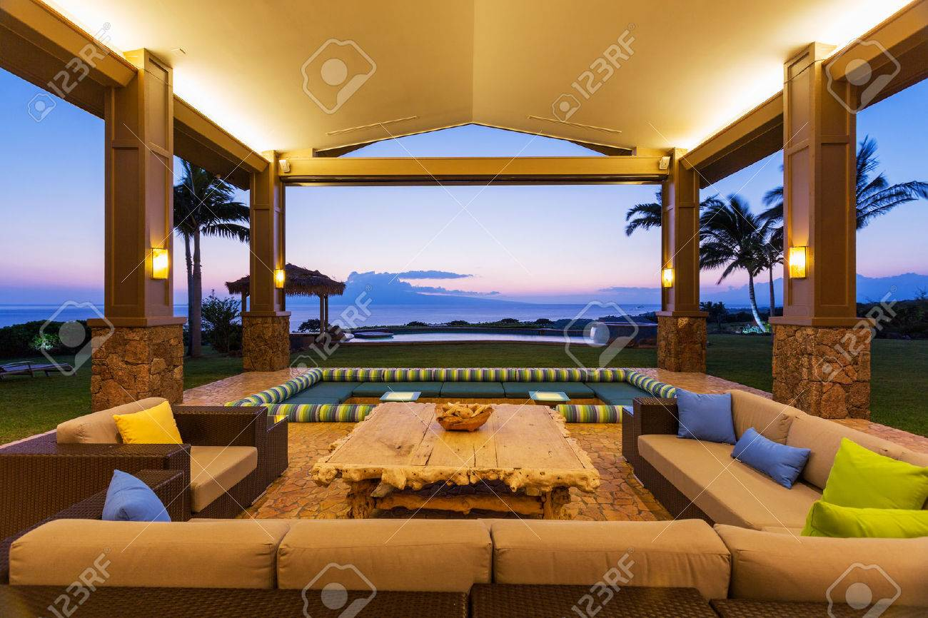 Beautiful Luxury Home, Exterior Patio Lounge At Sunset Stock Photo