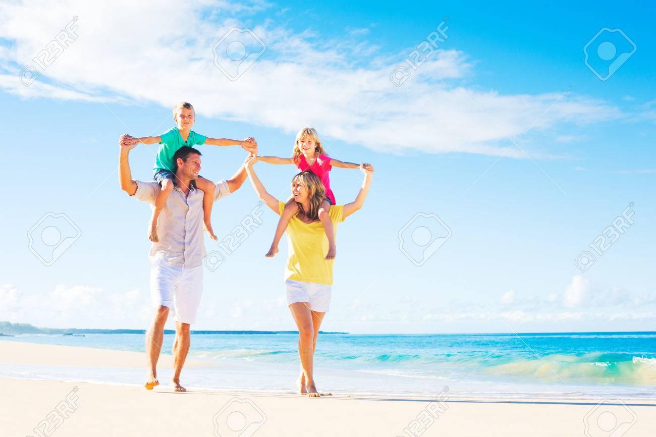 Family of four having fun on tropical beach - 31913866
