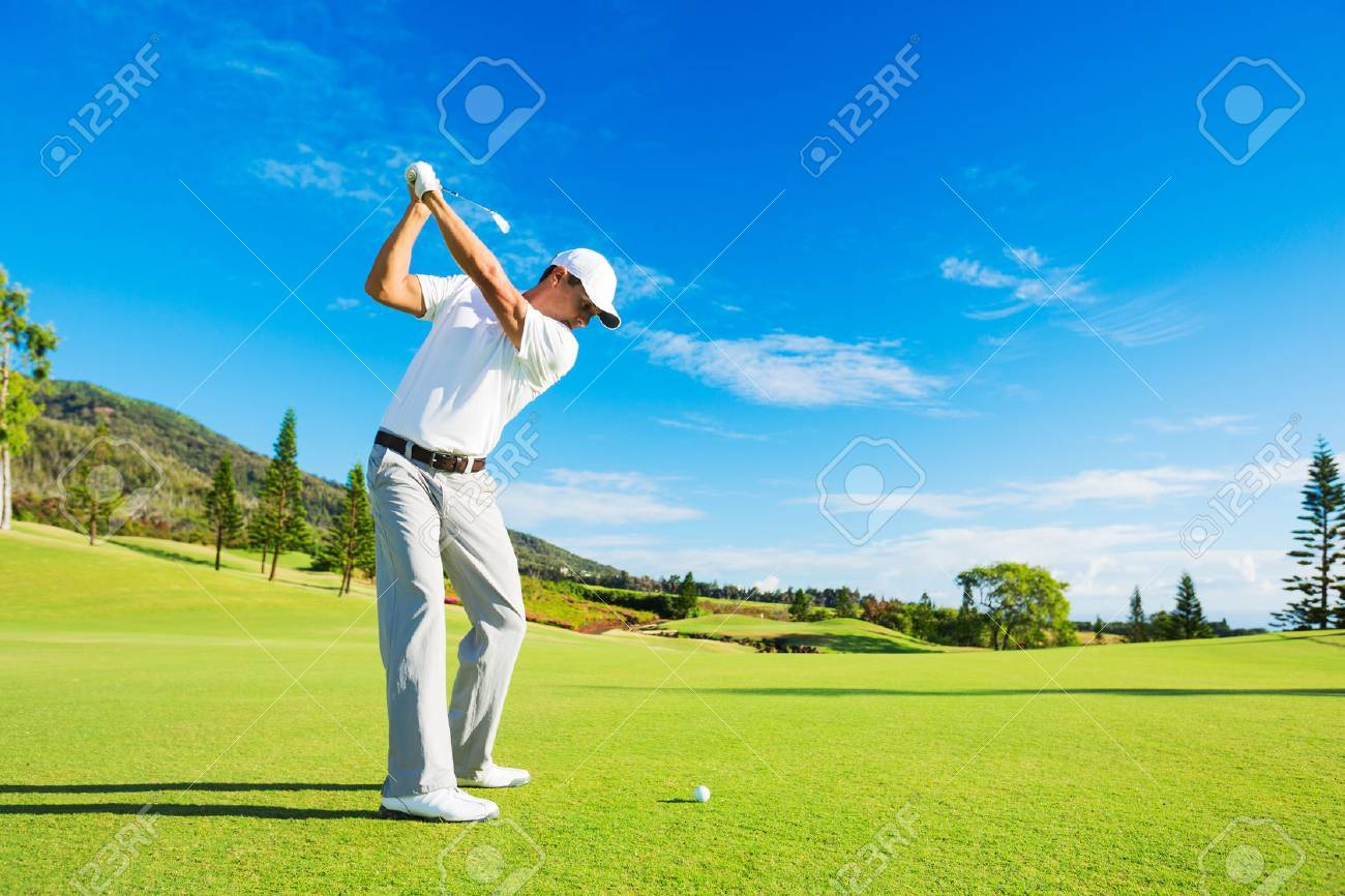 Golfer Hitting Golf Shot with Club on the Course - 32218517