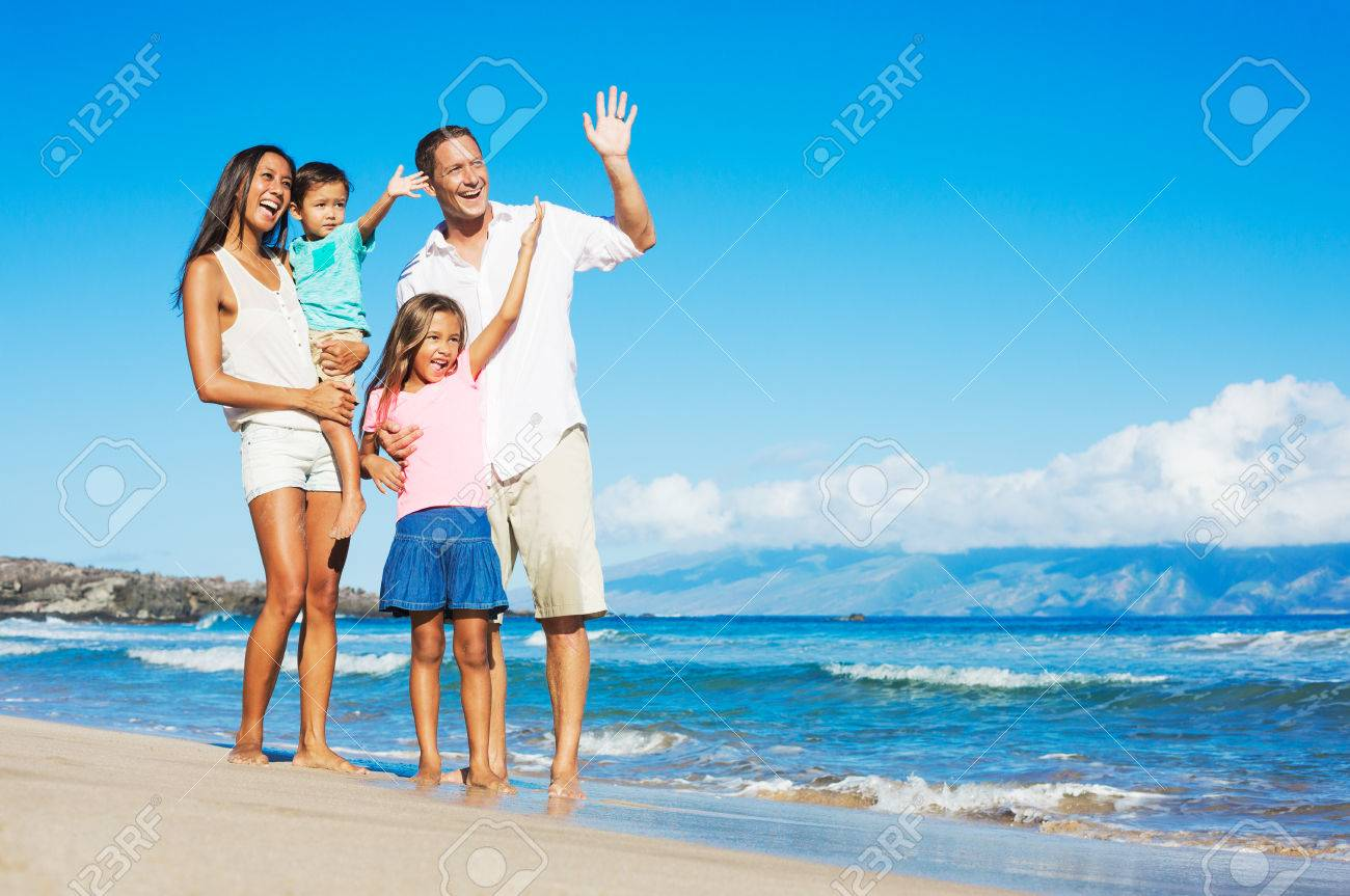 Happy Mixed Race Family of Four Playing on the Beach - 32218569