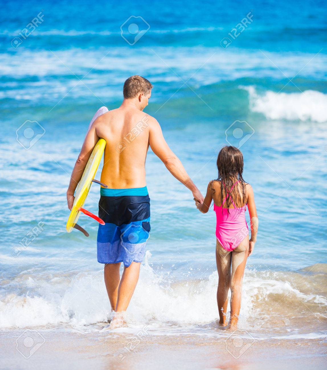 Father And Daughter On The Beach Going Surfing Together In Hawaii Summer Lifestyle Family Concept