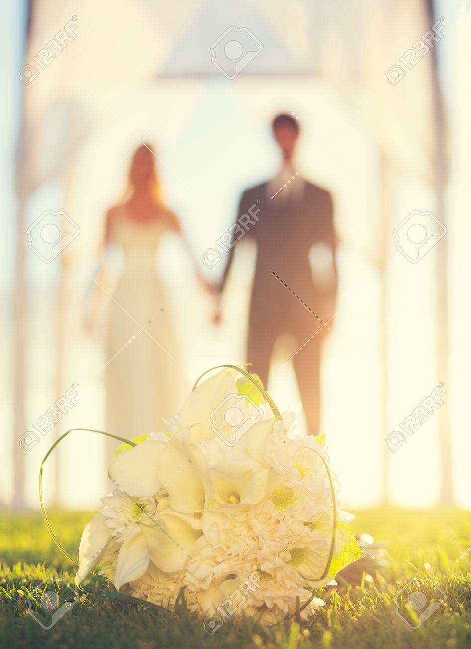 Close Up Of Wedding Bouquet. Focus On Flowers. Bride And Groom ...