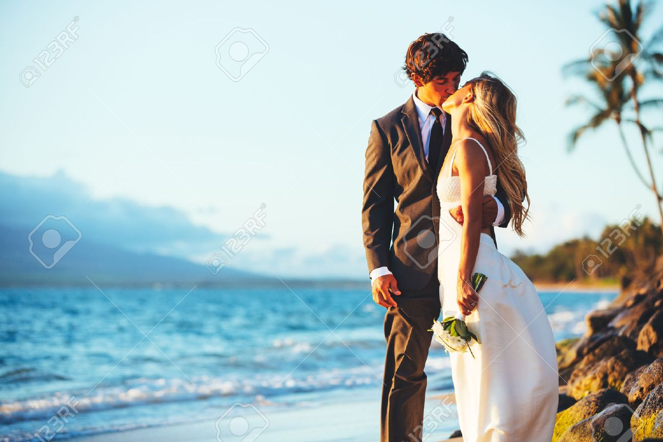 Romantic Wedding Couple Kissing on the Beach at Sunset - 32338066