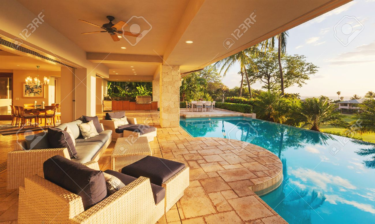 Luxury House Pool beautiful luxury home with swimming pool at sunset stock photo