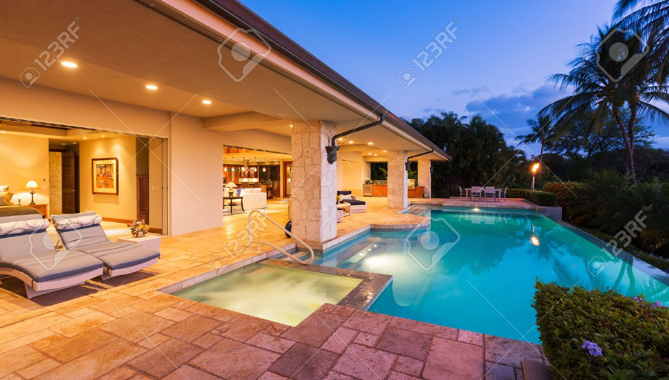 Beautiful Luxury Home with Swimming Pool at Sunset - 42854205
