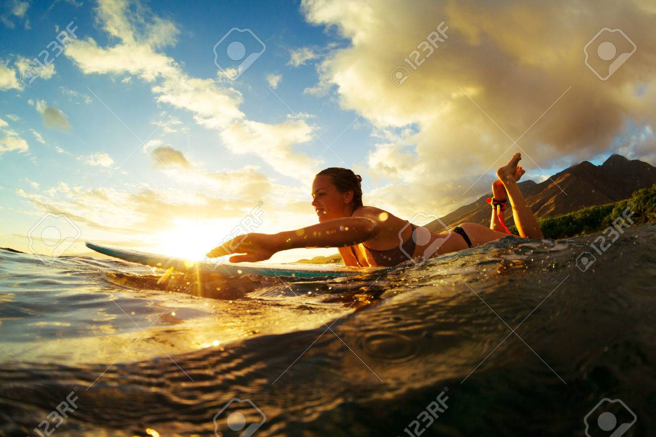 Surfing at Sunset. Outdoor Active Lifestyle. Stock Photo - 43728219