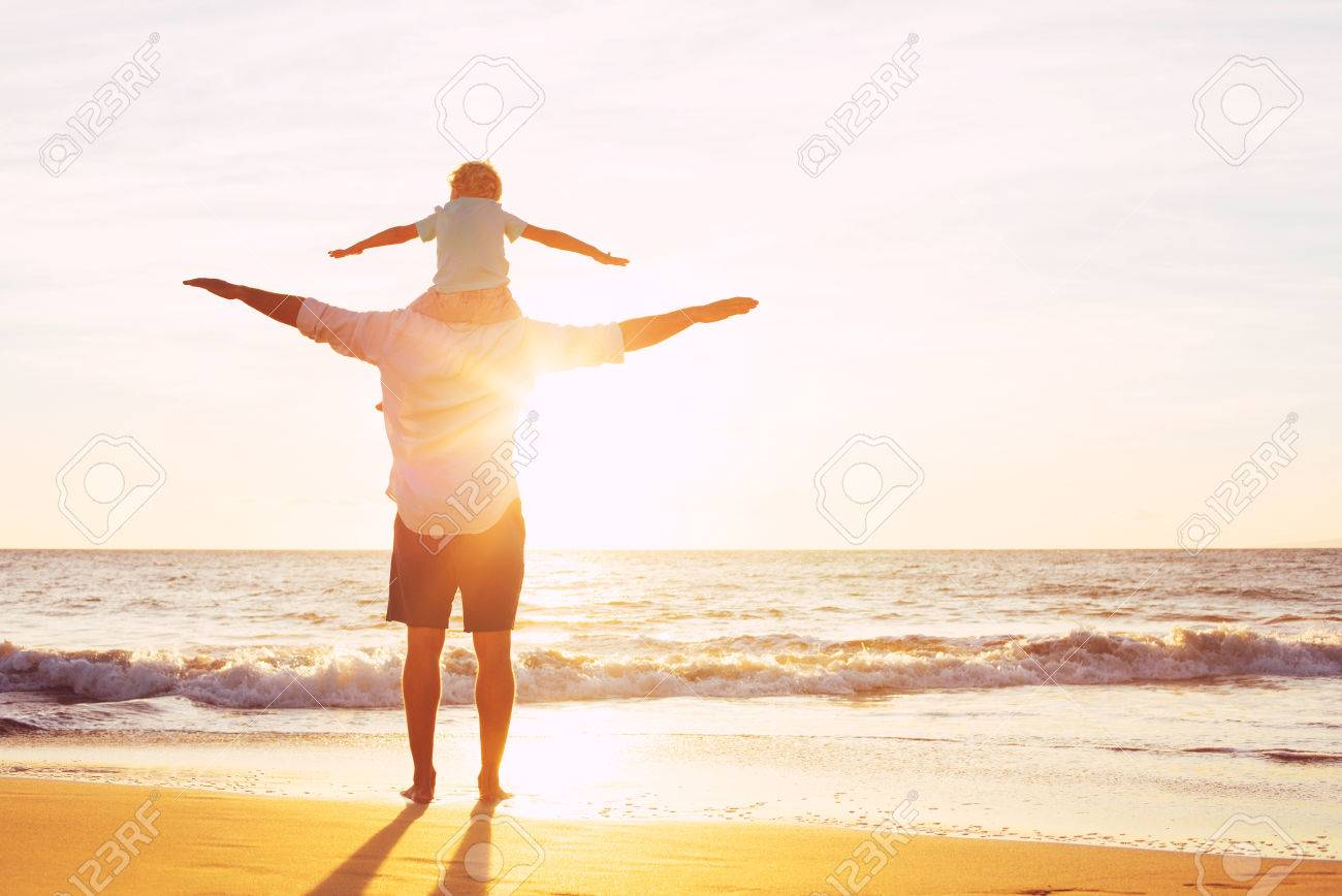 Father and Son Playing on the Beach at Sunset, Having Quality Family TIme Together. Stock Photo - 48764012