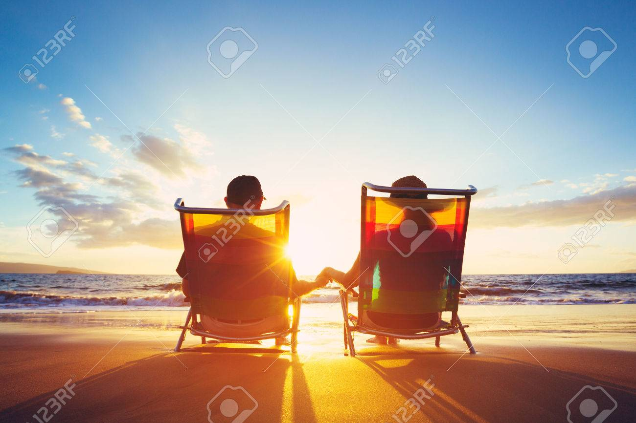 Retirement Vacation Concept, Happy Mature Retired Couple Enjoying Beautiful Sunset at the Beach Stock Photo - 48837144