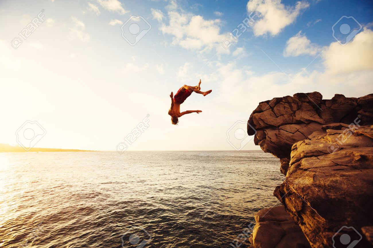 Cliff Jumping into the Ocean at Sunset, Outdoor Adventure Lifestyle - 48837158