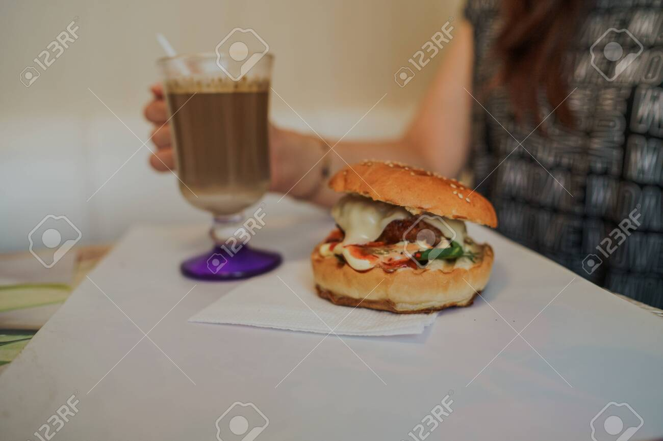 Food Photography Hot Cappuccino With Hamburger At The Table In Fast Food Cafe Cheeseburger And Coffee On The Table Drink Is Containing Caffeine Fotos Retratos Imagenes Y Fotografia De Archivo Libres De