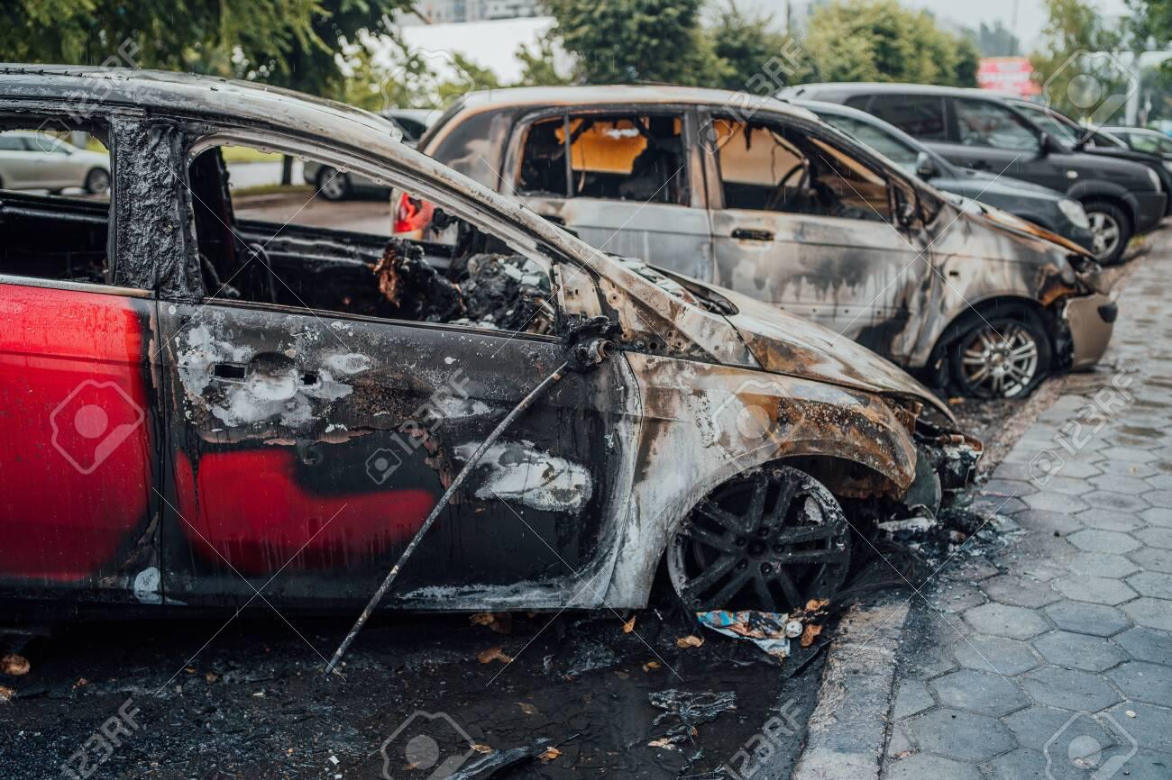 Vandalism or revenge, burnt car. The consequences of popular protest, burnt car, a crime. Car after fire. Auto trash - 145964818