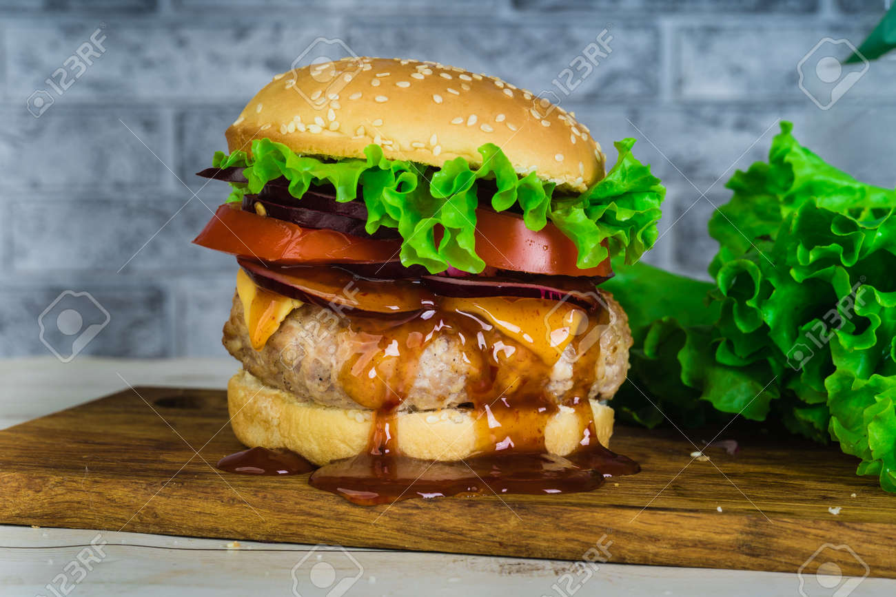 hamburger or sandwich. Delicious sandwich hamburger with meat, cheese and fresh vegetable. - 133500166