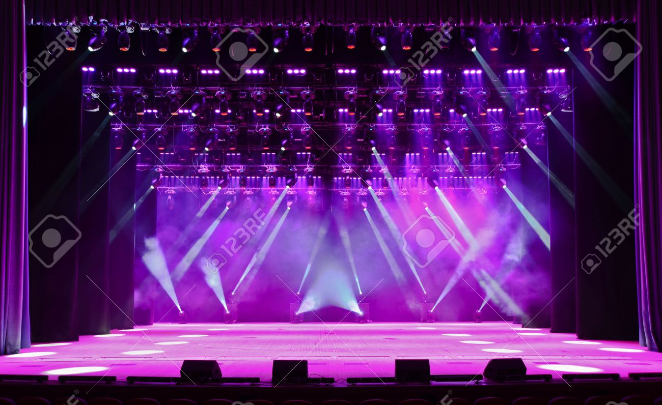 Empty outdoor rock stage - Acting Stage Illuminated Empty Concert Stage With Smoke And Rays Of Light Stock Photo