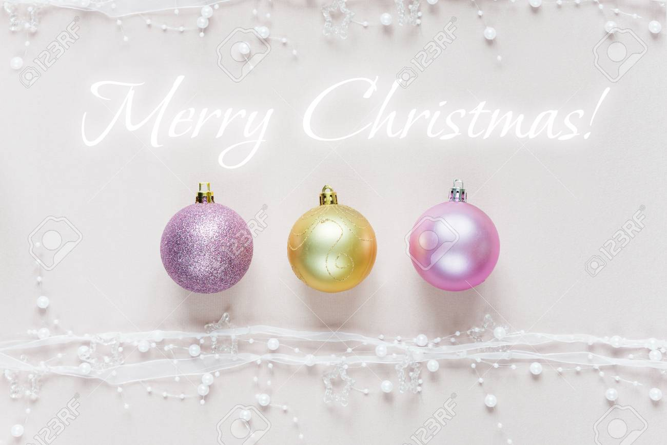 Christmas Greeting Card With Christmas Balls On A Pink Background ...